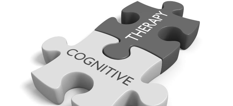 dos fichas unidas de un puzle con las palabras cognitivo y la terapia