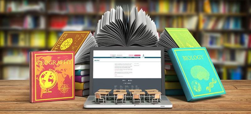 biblioteca, serie de la universidad, libros y un ordenador con un apantalla en el fondo unos pupitres de juguete