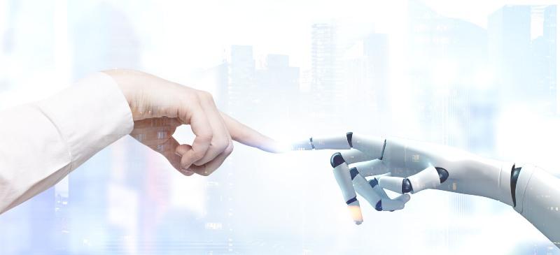 Inteligencia artificial de una mano humana y una de robot tocándose con el dedo, como Dios y el hombre en la capilla Sixtina.
