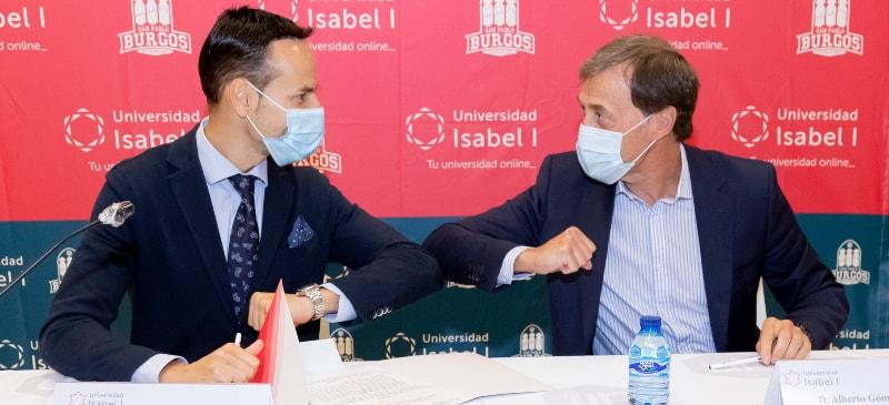 El rector de la Universidad Isabel I y el presidente del Hereda San Pablo se saludan en la firma del convenio